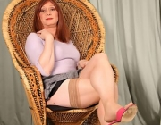 Irresistible TRANS-WOMAN Luci May hitches up her mini skirt and grabs her thick phallus.