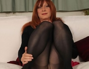 Luci May is crazy about her long stockings and high heel pumps